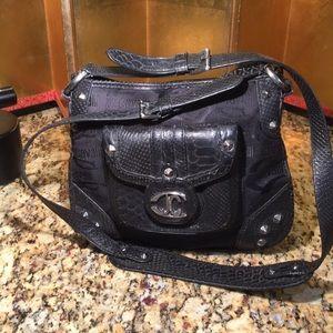 Fierce studded crossbody bag by Just Cavelli